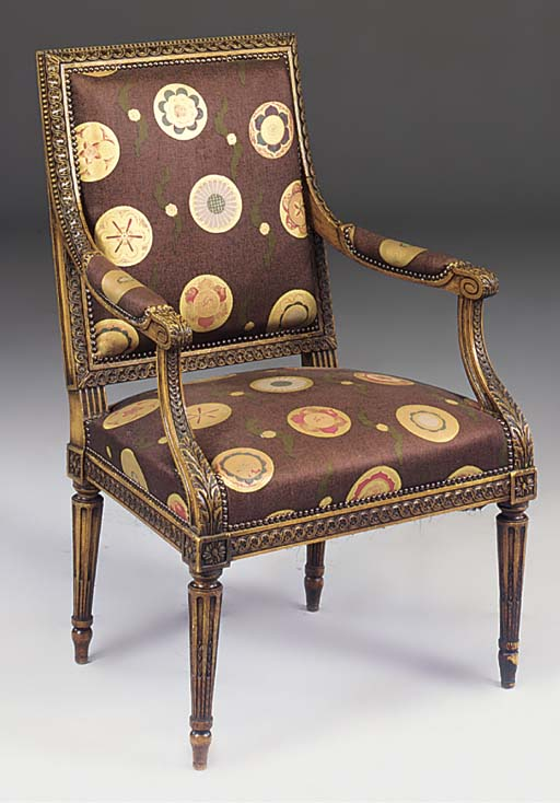 A BEECHWOOD AND UPHOLSTERED FA