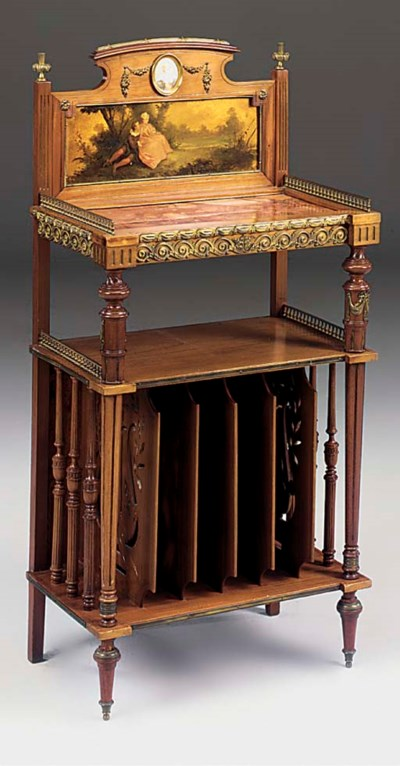 AN ORMOLU MOUNTED MAHOGANY AND