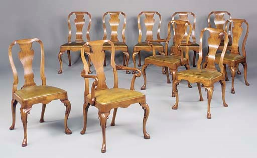 A SET OF TEN WALNUT AND LEATHE