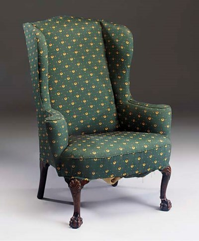 A MAHOGANY WING BACK ARMCHAIR