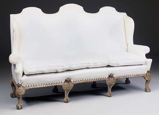A LARGE CARVED MAHOGANY SOFA