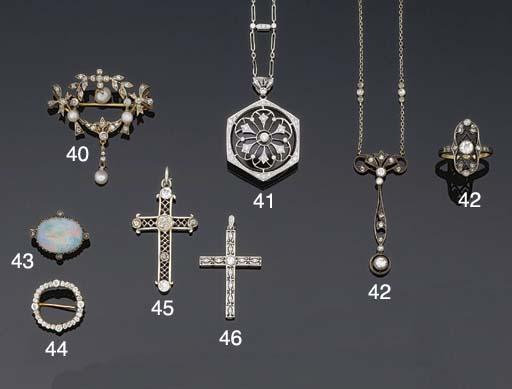 A diamond cross pendant