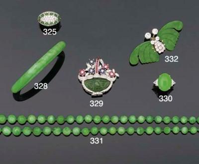 A JADEITE AND DIAMOND RING,