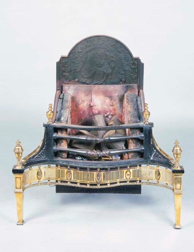 A BRASS AND CAST IRON FIRE GRA