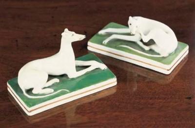 A pair of English porcelain mo