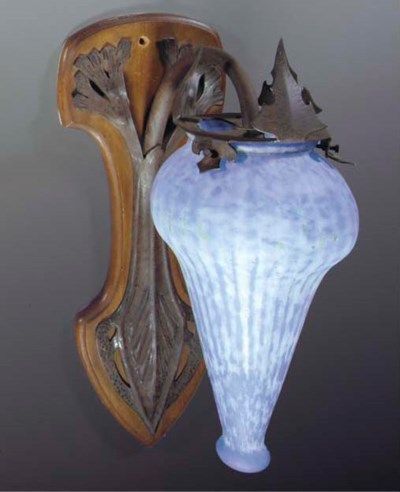 A PATINATED METAL AND GLASS WA