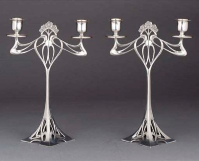 A PAIR OF TWIN-SCONCED SILVERE
