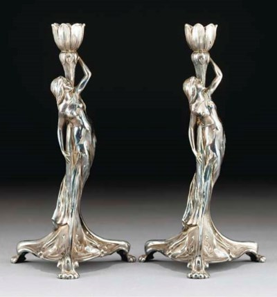 A PAIR OF SILVERED METAL FIGUR