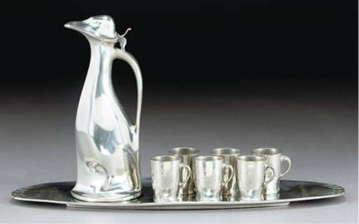 A SILVERED METAL DECANTER SET