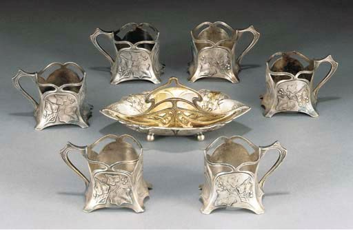 A SET OF SIX PEWTER CUP HOLDER