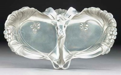 A SILVERED METAL DOUBLE-TRAY