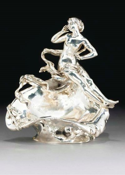 A SILVERED METAL FIGURAL TRAY