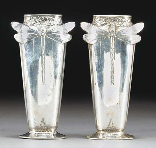 A PAIR OF SILVERED METAL VASES