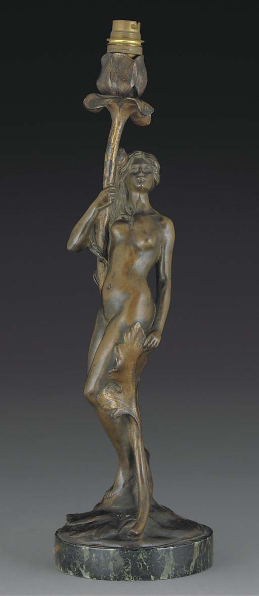 A PATINATED BRONZE FIGURAL LAM