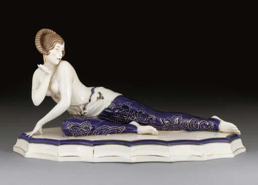 A gilt porcelain figure