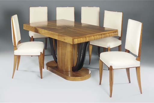 A WALNUT DINING SUITE