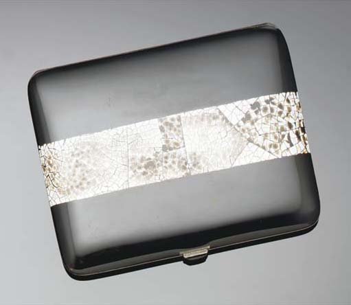 A silver, lacquer, eggshell an