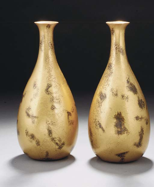 A pair of gilt bronze vases