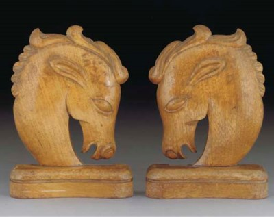 A pair of wood figural bookend