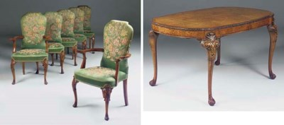 A BURR WALNUT AND WALUT DINING