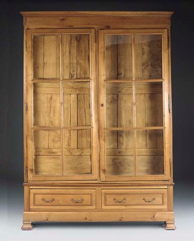 A FRENCH CHERRYWOOD BOOKCASE