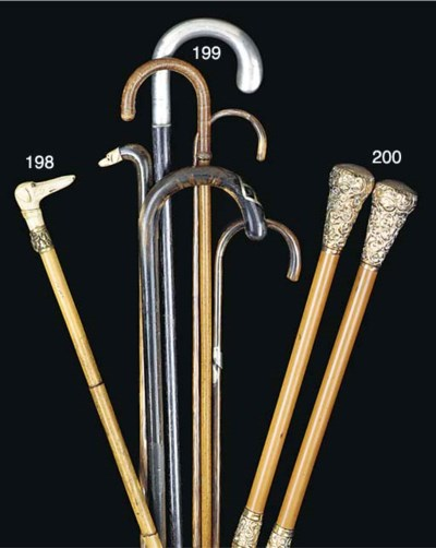 An antler mounted bamboo cane