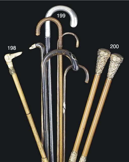 Twelve assorted walking sticks