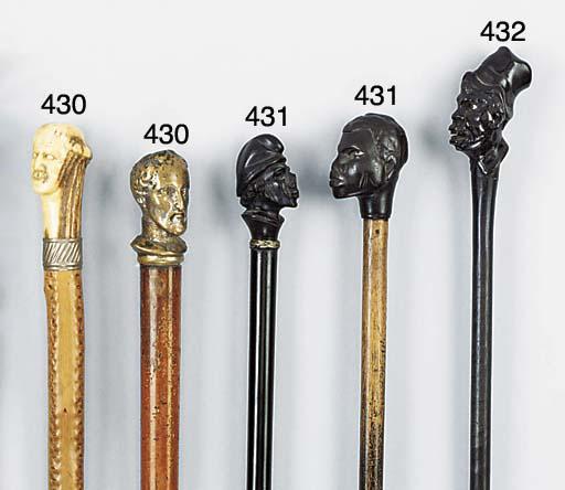 A carved ebony walking stick