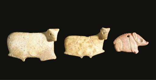 A MESOPOTAMIAN RED SOAPSTONE A