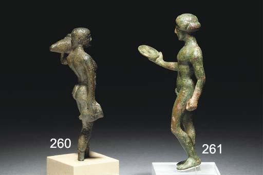 A GREEK BRONZE STATUETTE OF APOLLO