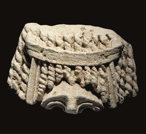 A ROMAN FRAGMENTARY STONE MASK OF A HETAIRA