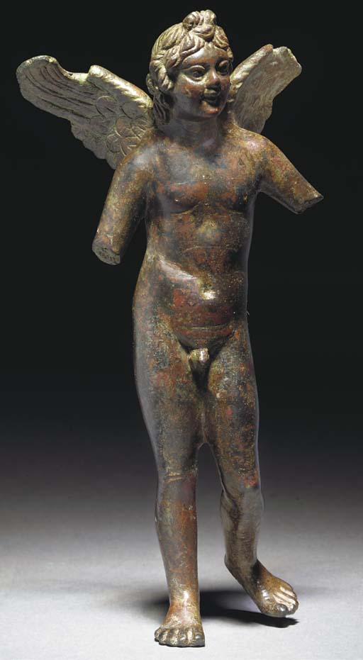 A GRAECO-EGYPTIAN BRONZE FIGURE OF WINGED EROS
