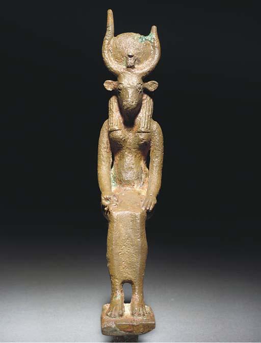 AN EGYPTIAN BRONZE COW-HEADED
