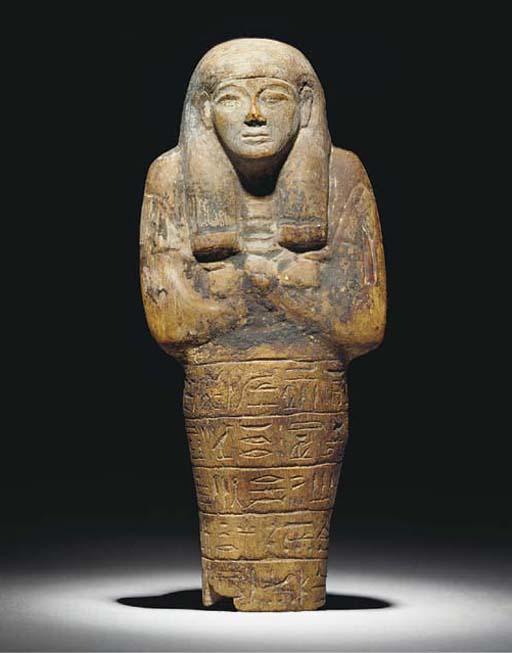 AN EGYPTIAN LIMESTONE SHABTI,