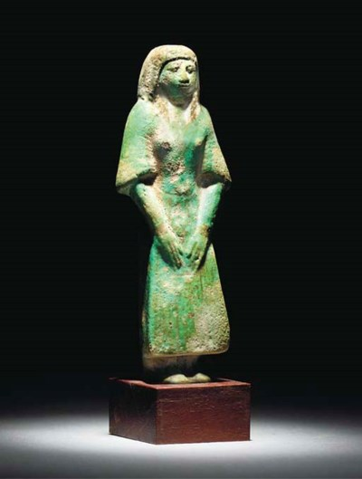 AN EGYPTIAN TURQUOISE GLAZED C