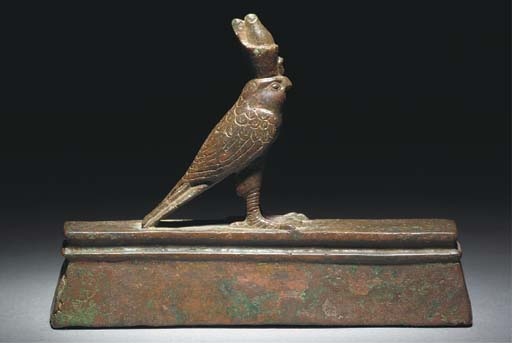 AN EGYPTIAN BRONZE FIGURE OF H