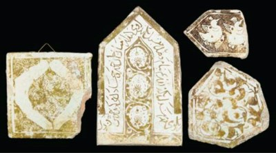 Four lustre pottery tiles and