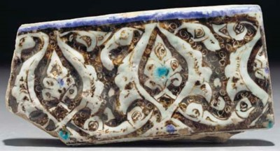 A Kashan moulded lustre fragme