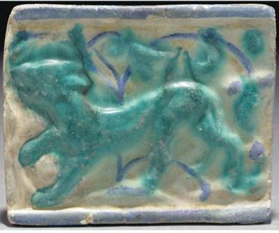 A Kashan moulded lustre, turqu