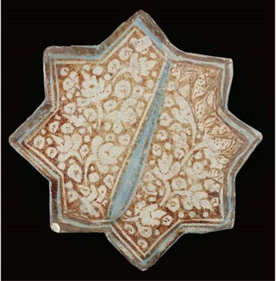 A Kashan lustre and cobalt blu