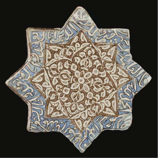 A Kashan lustre and cobalt-blu