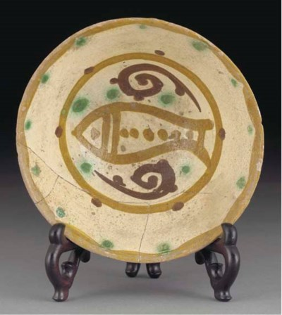 A Nishapur slip painted potter