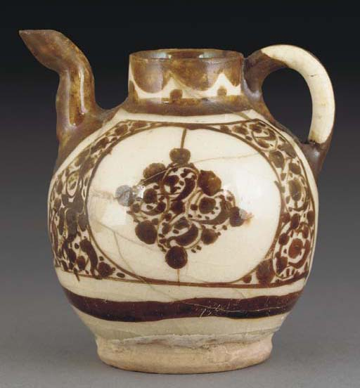 A Kashan lustre pottery pourin