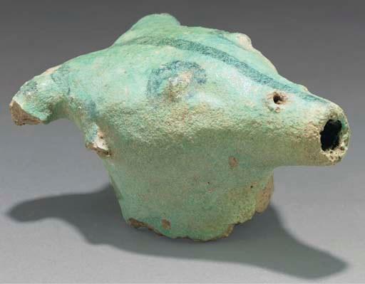 A turqoise glazed head of a ho