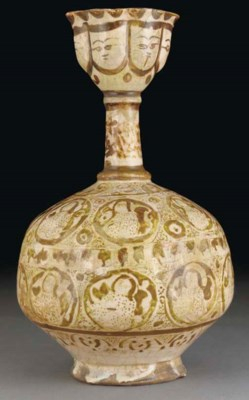 A Kashan lustre pottery bottle
