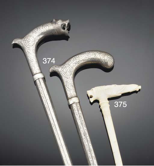 An Indian ivory walking stick,