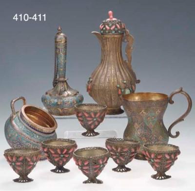 An Ottoman brass ewer and six