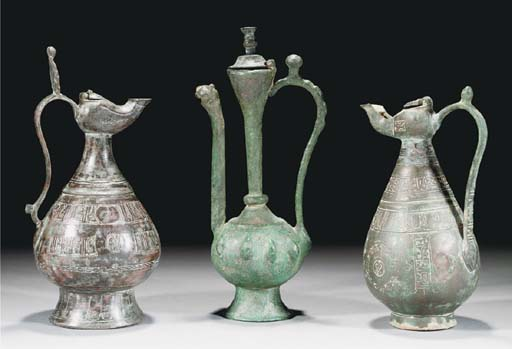 A group of four Seljuk ewers and oil lamps, 12th Century