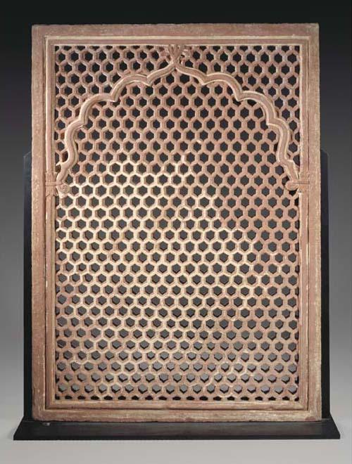 An Indian red sandstone jali,