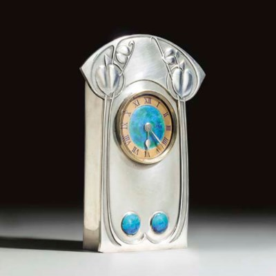 A Tudric Pewter and Enamel Clo